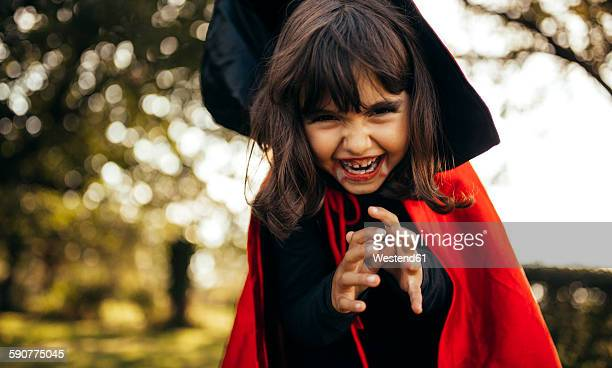 Portrait of little girl masquerade as vampire