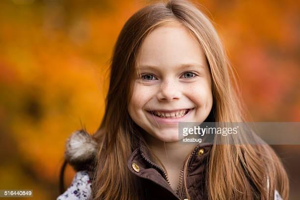 Portrait of Little Girl Outside on Fall Day