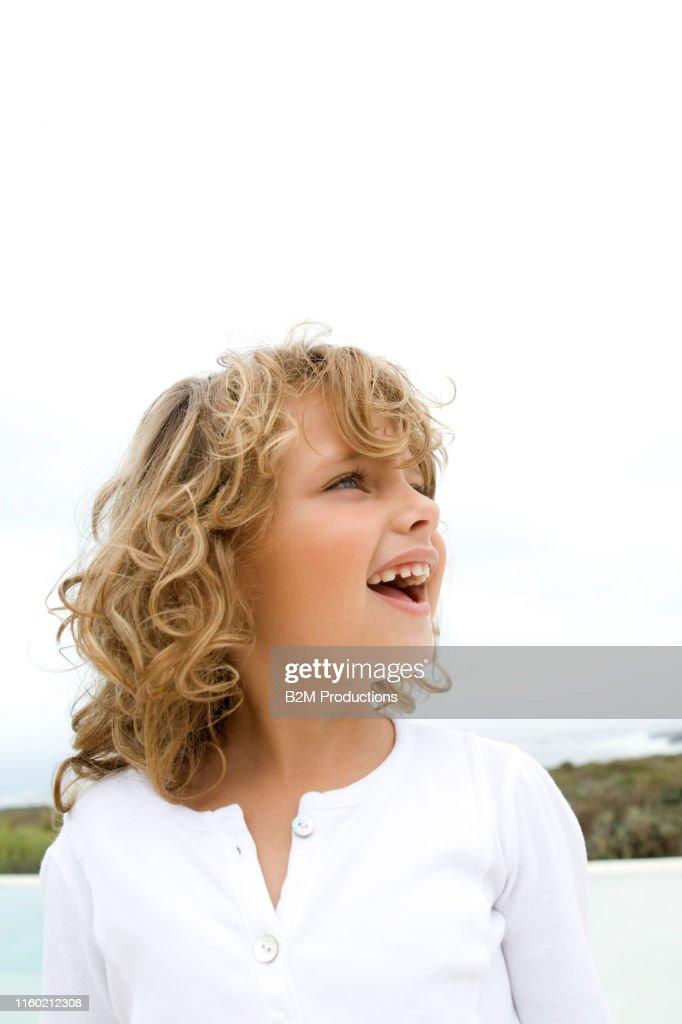 Little Girl Picking Blueberries High-Res Stock Photo