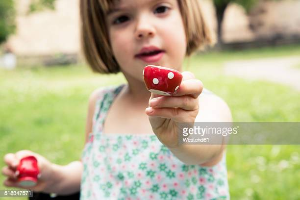 portrait of little girl playing with doll's china set in the garden - red alert 2 stock pictures, royalty-free photos & images