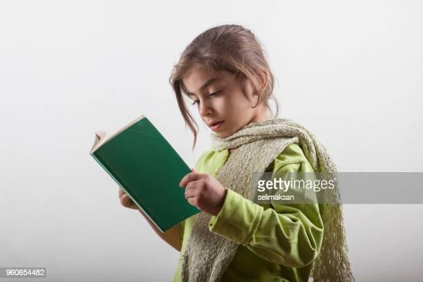 Portrait Of Little Girl Reading Book