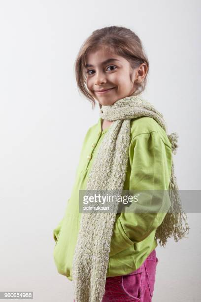 Portrait Of Little Girl Wearing A Green Coat