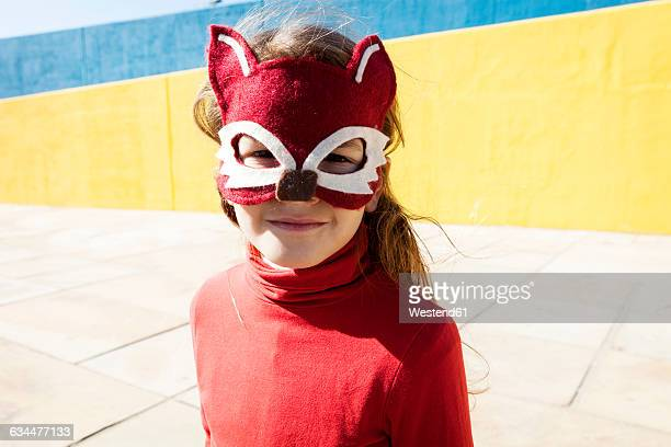 portrait of little girl wearing animal mask - mask disguise stock pictures, royalty-free photos & images