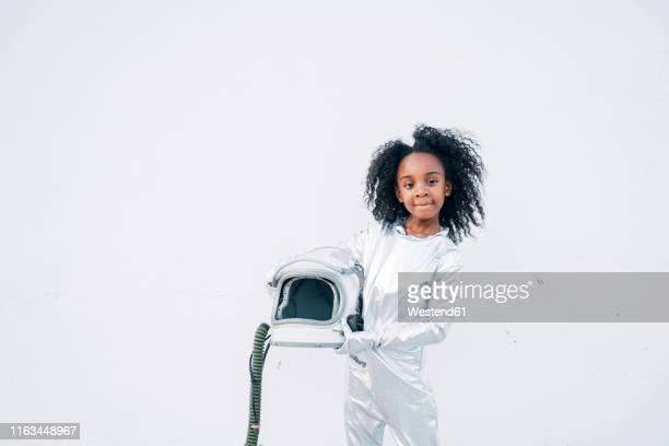 portrait of little girl wearing space suit in front of white background - astronaut stock pictures, royalty-free photos & images