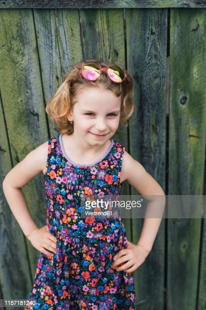 portrait of little girl wearing summer dress with floral design - floral pattern dress stock pictures, royalty-free photos & images