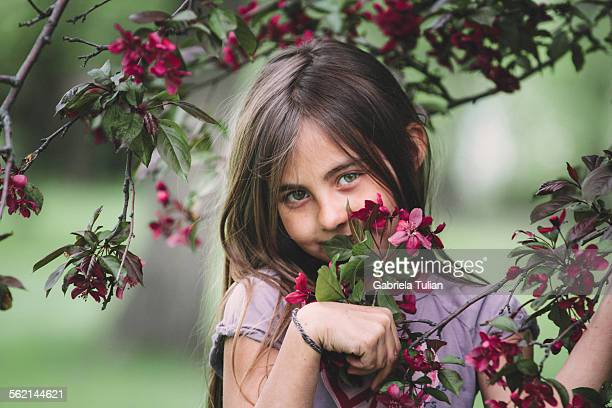 Portrait of little girl with blossom cherry trees