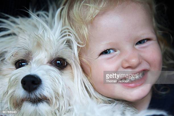 Portrait of little girl with dog
