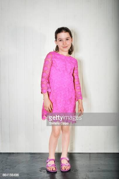 portrait of little girl with fuchsia dress - 16:9 ストックフォトと画像