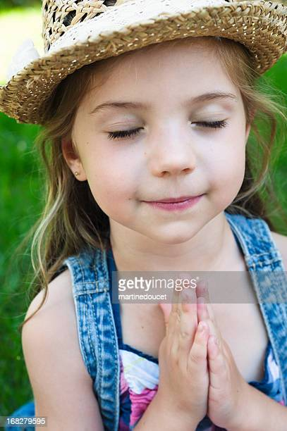 """portrait of little girl with hat praying. - """"martine doucet"""" or martinedoucet stock pictures, royalty-free photos & images"""