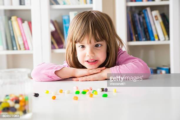 portrait of little girl with jelly beans - cross eyed stock pictures, royalty-free photos & images