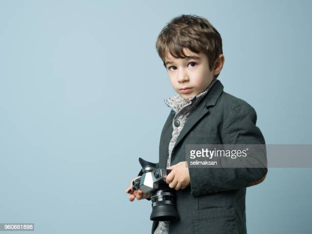 Portrait Of Little Photographer With Camera