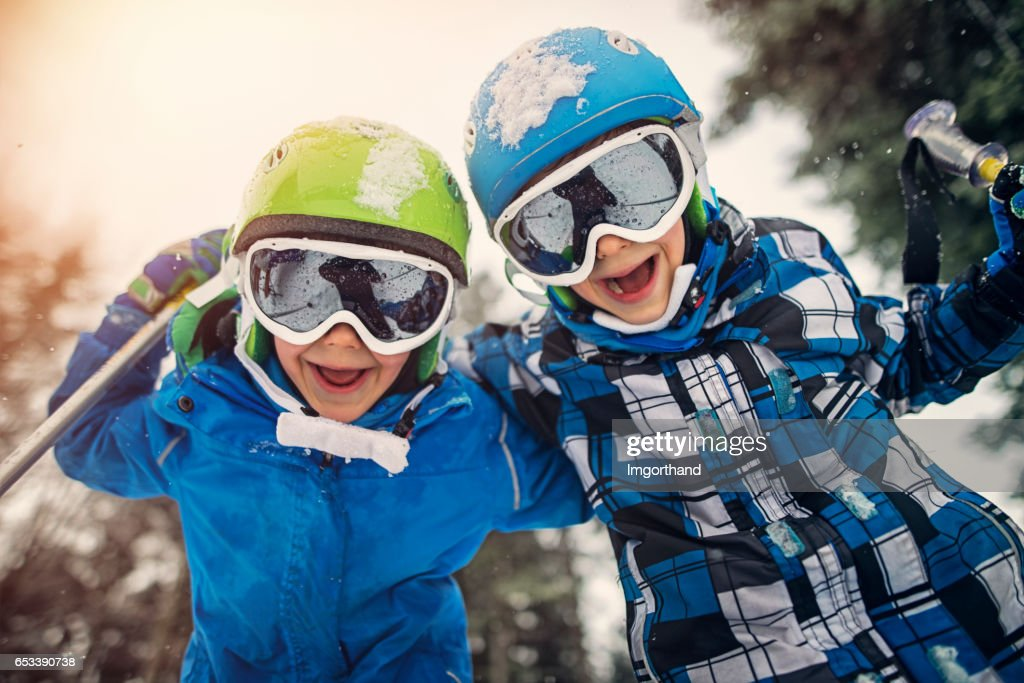 Portrait of little skiers  laughing at the camera : Stock Photo