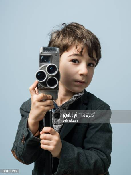 Portrait Of Little Videographer With Camera