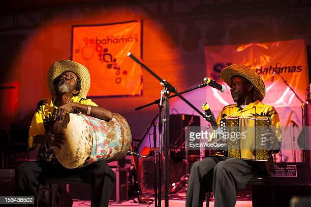 Portrait of local bahamian old men musicians who are playing typical Rake 'n' Scrape music with drum and accordion in a band at the annual Rake 'n'...