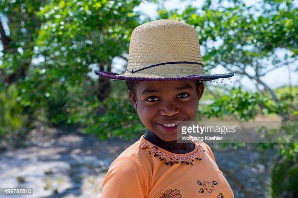 Portrait of local girl with straw hat near Fort Dauphin a town on the southern coast of Madagascar