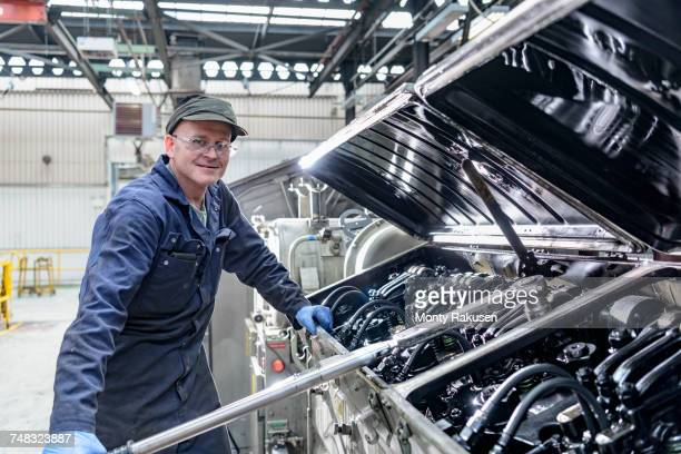 Portrait of locomotive engineer in train works