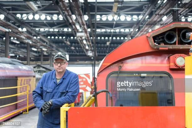 Portrait of locomotive engineer working in train works