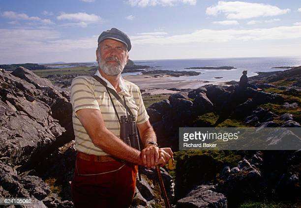 A portrait of Lord Strathcona on rocks of the Scottish island his family has owned for generations in the summer of 1989 on Colonsay Scotland Donald...