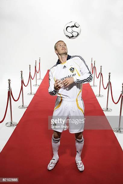 Portrait of Los Angeles Galaxy David Beckham juggling ball