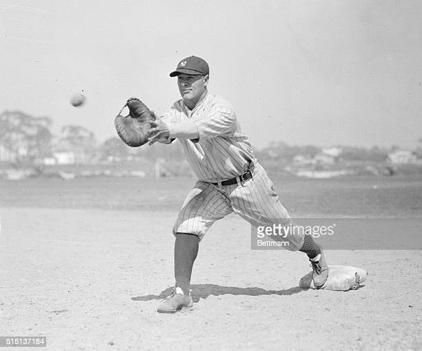 Portrait of Lou Gehrig catching ball on first base action pose.