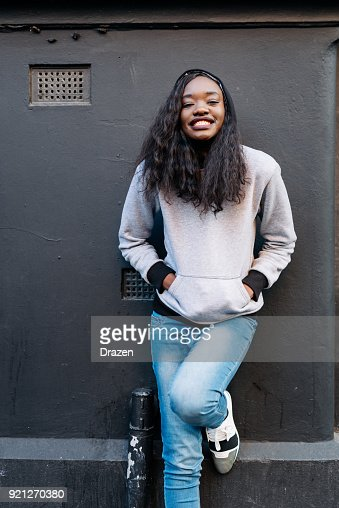 Portrait of lovely African woman in jeans and jumper