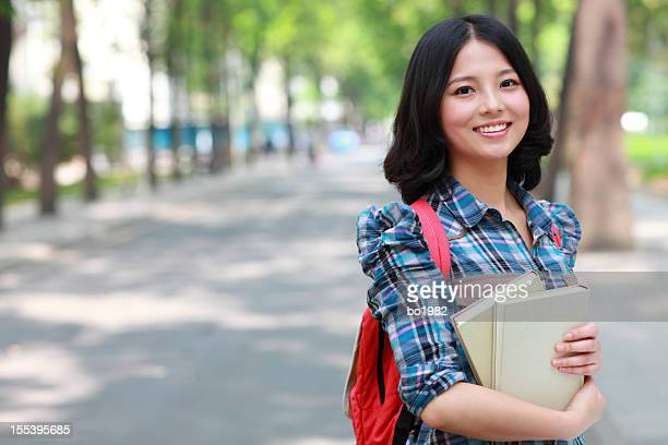 portrait of lovely Chinese college student in campus
