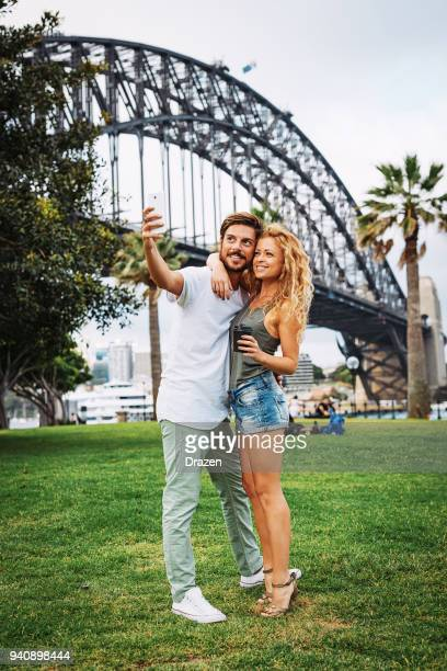portrait of lovely people taking selfie - international landmark stock pictures, royalty-free photos & images