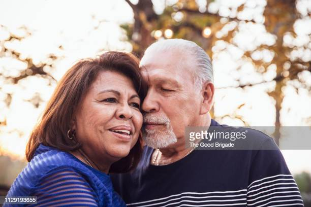 portrait of loving senior couple outdoors - nosotroscollection stock pictures, royalty-free photos & images