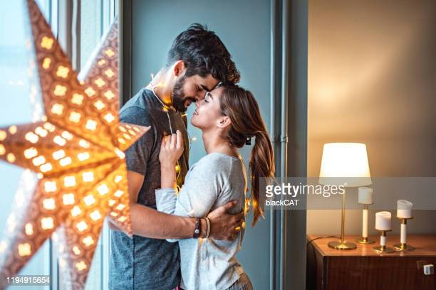 portrait of loving young couple at home - love at first sight stock pictures, royalty-free photos & images