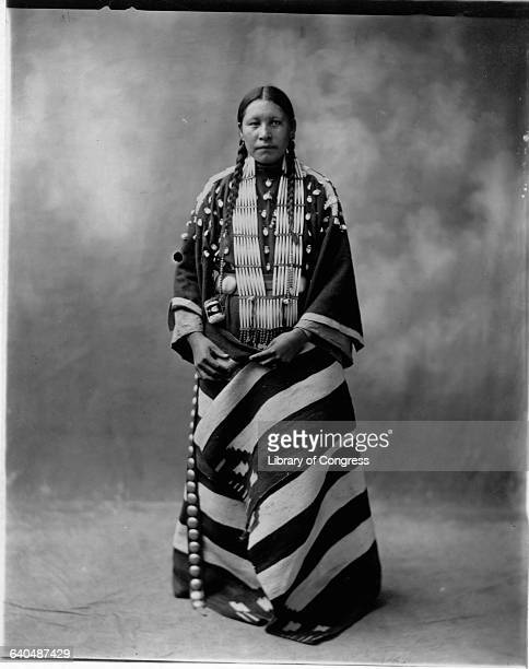 Portrait of Lucy Red Cloud a Sioux Indian woman wearing ceremonial clothing