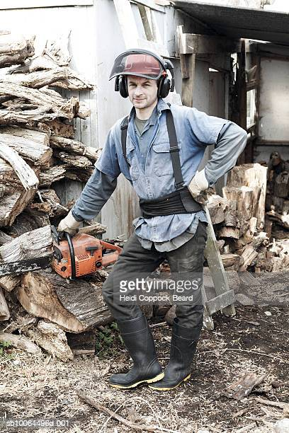portrait of lumberjack near woodpile outdoors - heidi coppock beard bildbanksfoton och bilder