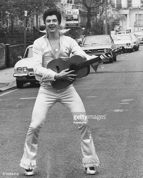 Portrait of lyricist Tim Rice wearing an Elvis Presley costume as the character 'Rick Pharaoh', as he will appear in the musical 'Joseph and his...