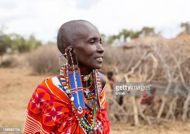 Portrait of Maasai woman outside village.