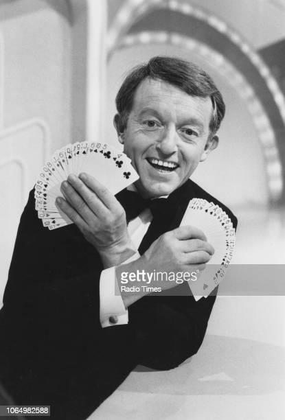 Portrait of magician Paul Daniels holding a fanned out deck of cards April 1st 1985