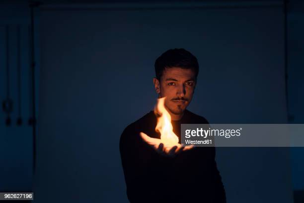 portrait of magician with flame - goochelaar stockfoto's en -beelden