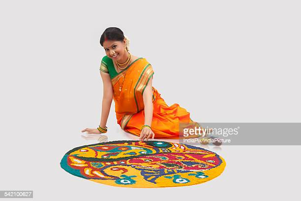 Portrait of Maharashtrian woman making a rangoli