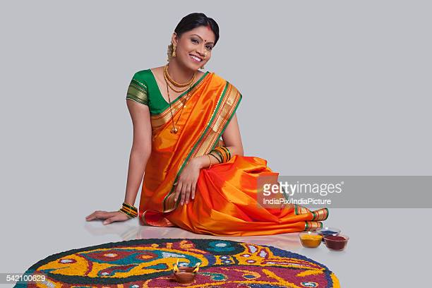 Portrait of Maharashtrian woman with a rangoli
