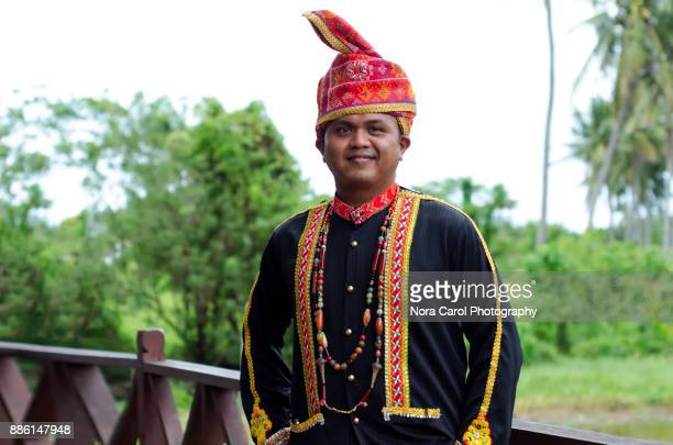 portrait of malaysia indigenous native dusun lotud in traditional clothing - sabah state stock pictures, royalty-free photos & images