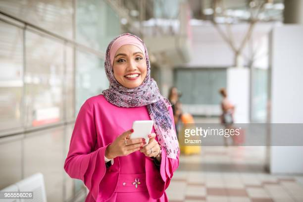 Portrait of Malaysian businesswoman in pink formal clothing