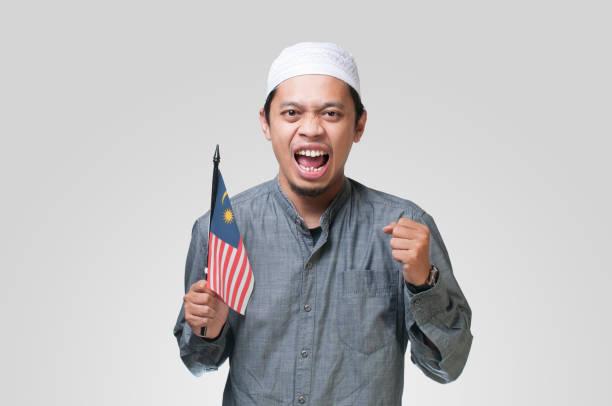Portrait of Malaysian holding Malaysia Flag