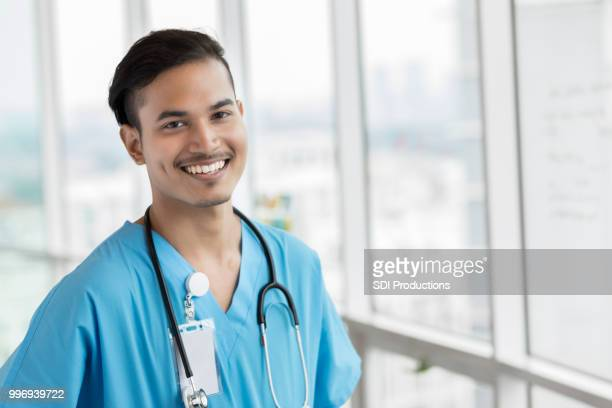 portrait of malaysian male doctor - malaysian culture stock pictures, royalty-free photos & images