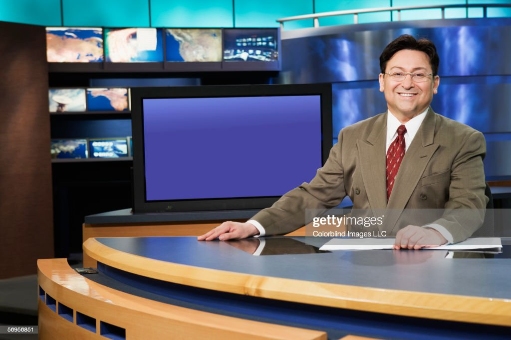 Portrait of male anchor in newsroom : Stock Photo