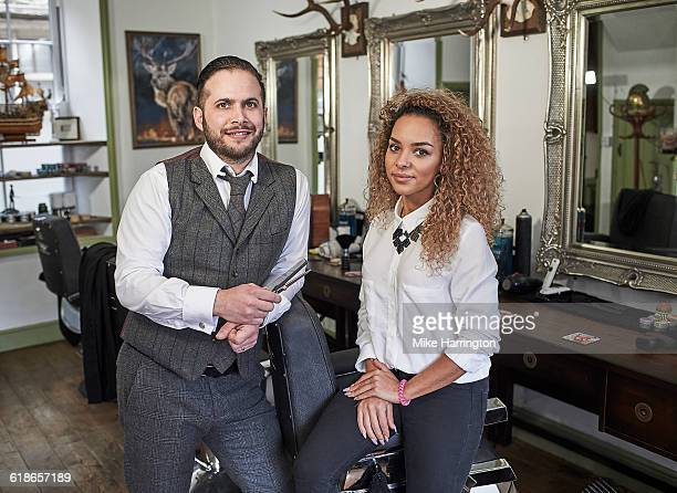 Portrait of male and female barber