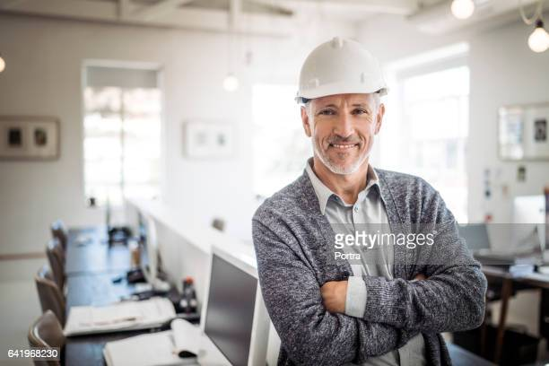 Portrait of male architect standing arms crossed