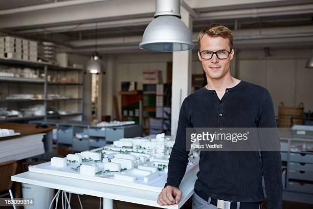 Portrait of male architect w. model made of foam