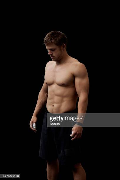 portrait of male athlete in crosssfit gym