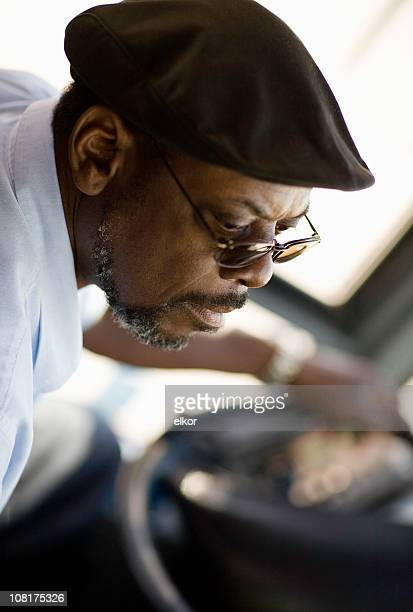 Portrait of Male Black Bus Driver Wearing Hat