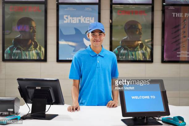 portrait of male cashier at ticket counter - cash register stock pictures, royalty-free photos & images