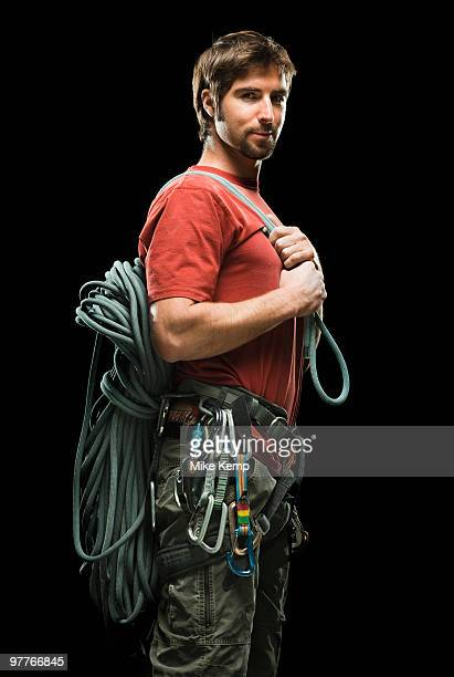 Portrait of male climber holding rope