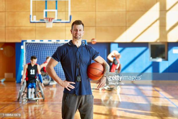 portrait of male coach and wheelchair basketball players - coach stock pictures, royalty-free photos & images
